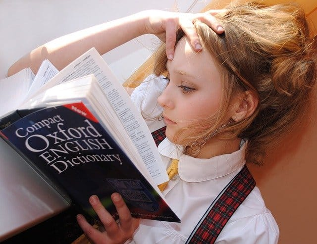 A girl reading a dictionary